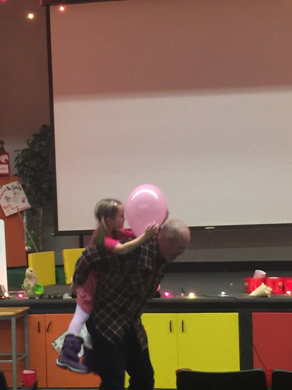 Grandpa got creative when they had to carry the balloon by their heads.
