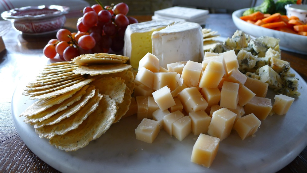Welcome guests with a cheese platter.