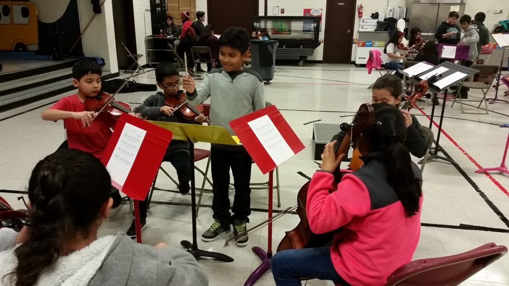 Moises, one of the Chamber Orchestra violists, teaching some of the Preludio students.