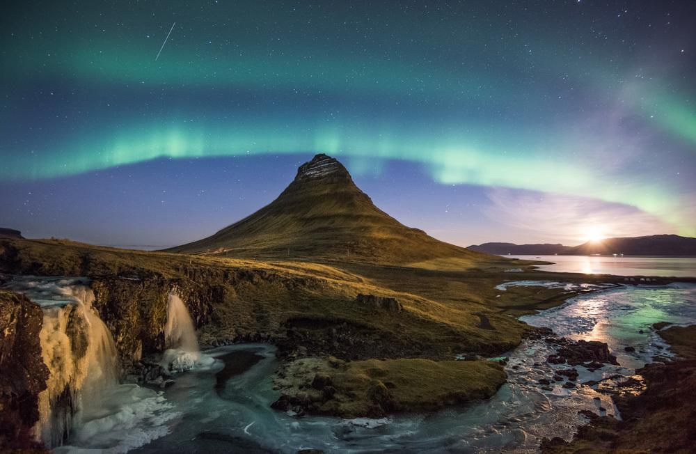 Kirkjufell Mountain and Kirjufellsfoss Under the Northern Lights