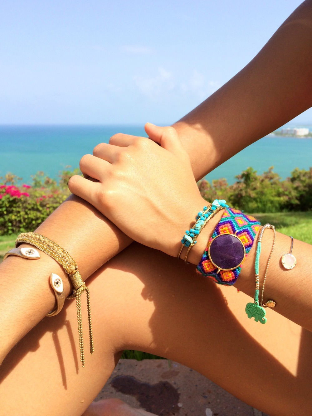 (From left to right)  Evil Eye Cuff, Urban Outfitters; Gold Beaded Tassel Bracelet, Urban Outfitters; Gold/Turquoise Stone Cuff, Nordstrom; Teal Elephant Double-Strand Bracelet, Flea Market; Gold Cuff w/ Stone, LF.