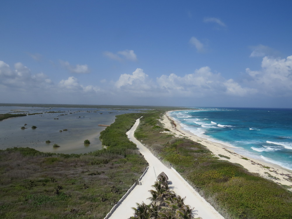 View from the Faro Cesarian (an Iconic Lighthouse in Cozumel, Mexico); a lagoon to the left and beaches to the right.