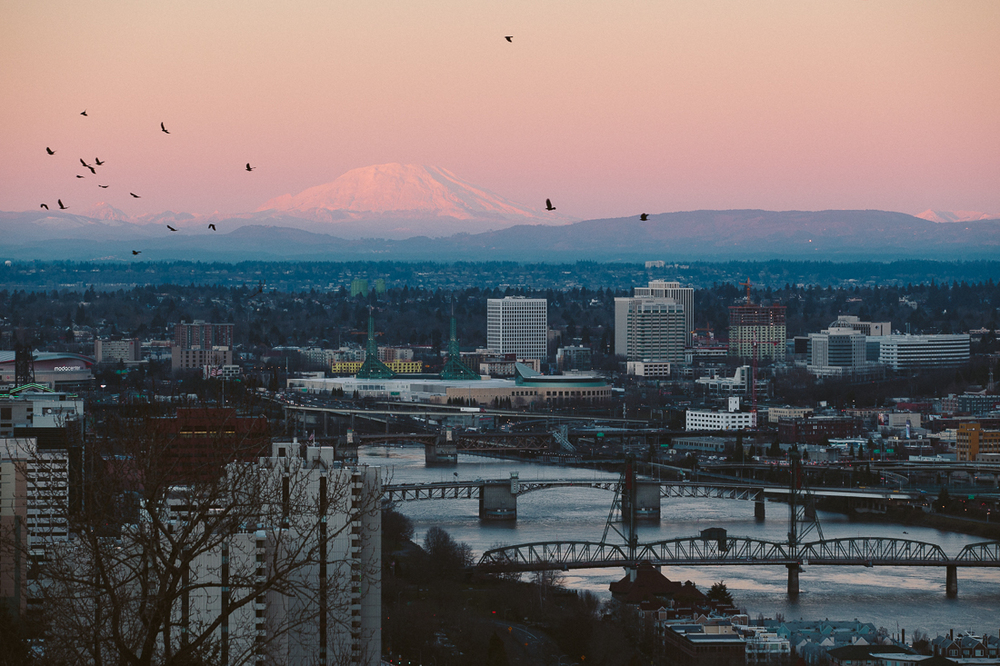 Portland, because it is a big port?  The big waterway means a lot of bridges, and a great sunset with Mt Saint Helens off in the distance.