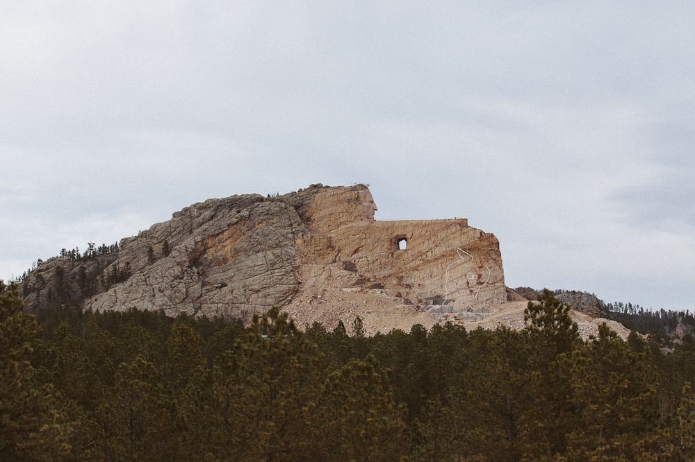 This is a  monument  in progress dedicated to the Native American Crazy Horse.  The story is tragic, the US Federal Government betrayed and murdered him.  You should read about it to make your own opinion on the topic.