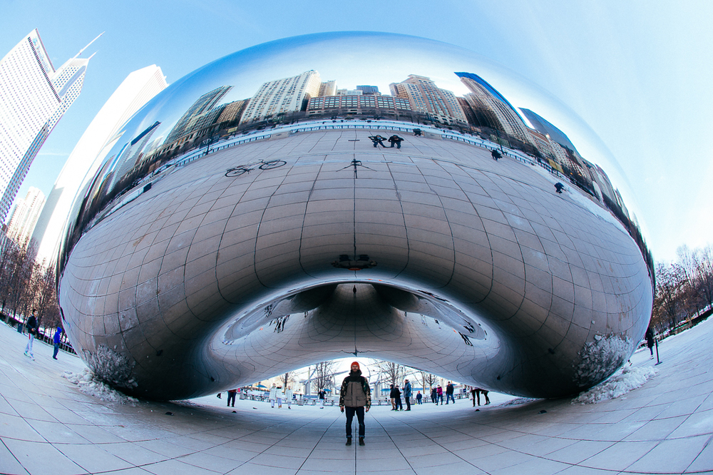 "The Bean is a classic ""selfie"" location in Chicago.  There were dozens of people here smiling at their cellphones and others were just staring at the reflection like they were on acid.  Anyhow, here's my self-portrait.  ...see the tripod & camera in the reflection?  That's how I do it."