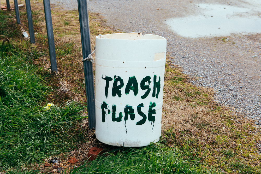 Is the owner asking you to please use the trash, or is this the Trash Place?  Or cleverly both and saving paint?!?!