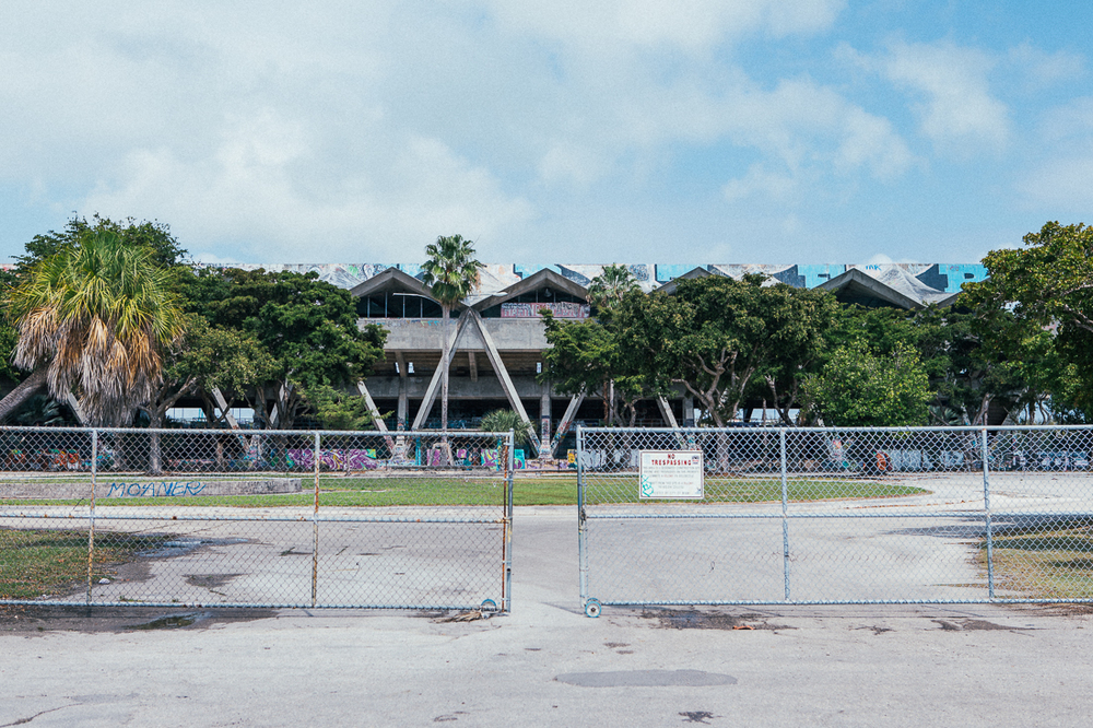 There's a law somewhere that if a gate is open it's not trespassing on that property. Well, I went in to this abandoned stadium in Miami to check out the crazy graffiti and quickly got kicked out by a security guard.