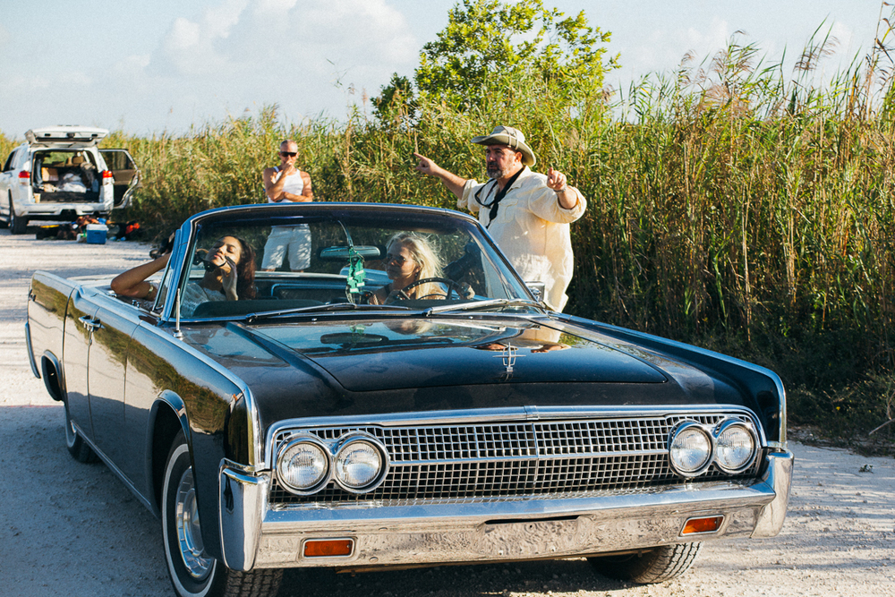 He rented a gorgeous 63 Lincoln Continental with suicide doors and electric convertible top.