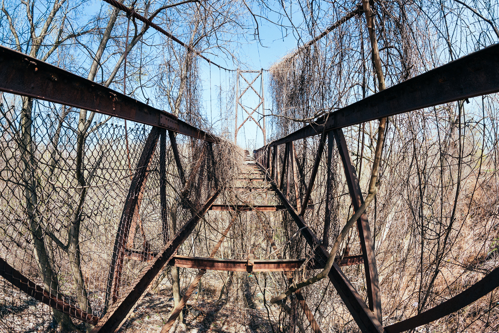 This use to be a pedestrian suspension bridge that connected two feuding neighborhoods of different cultures, and during a riot the wooden walkway was burned. Now it's just the rusted skeleton over a deep ravine, which I wasn't about to scramble over.