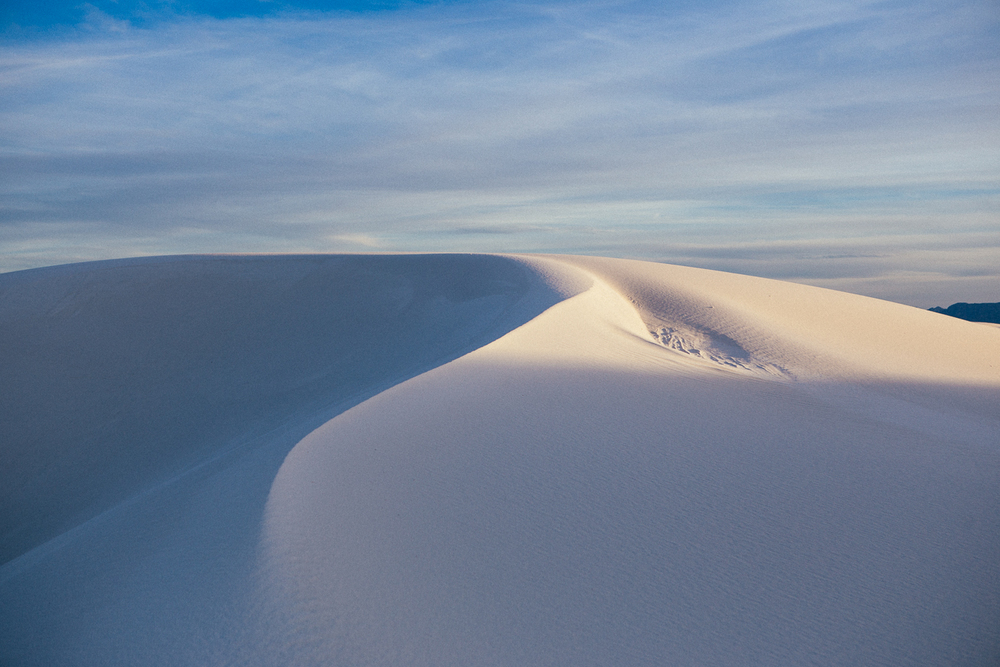 The last light on the dunes turn the white into amber and the shades to blue. Pretty pretty.