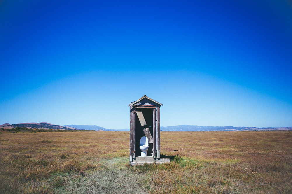 Out in this muddy marsh there's no other structure for miles. Is it an art installation, is it a redneck joke, or is it just a perfect photo op of an outhouse for me???