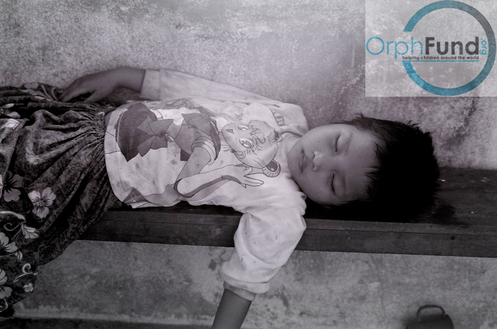 Girl Sleeping After a long and Hot Day - Sophy Village, Cambodia copy.jpg