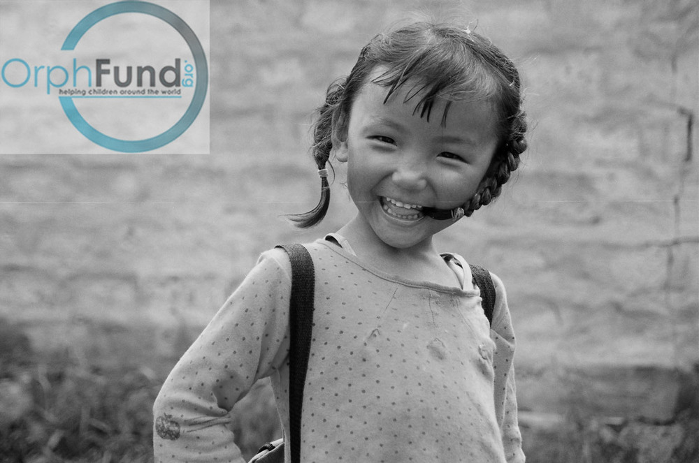 42 smiling girl in Tibet b&w copy.jpg