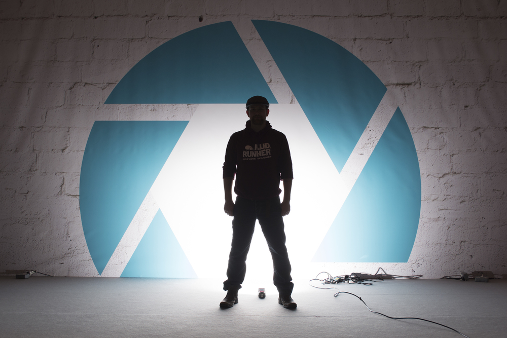 And lastly, I thought i'd have a bit of fun with the big logo that was at the back of the stage and using Off Camera Flash. So I but the flash on the floor and got Ben to stand in front of it, so that he wasn't lit by the flash, but the wall was.