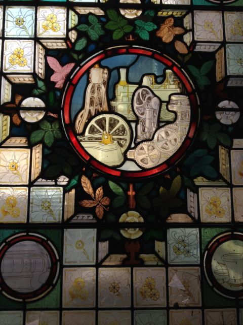 An original stained glass window from the 1880s building, designed in an Arts & Crafts style showing the most advanced Victorian machinery (traction engines, motorised looms). I was delighted to find the window in Bradford College today.