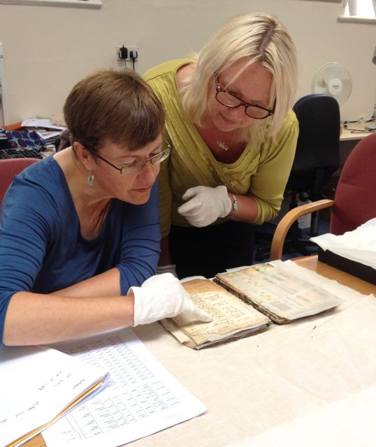 Artist Helen Parrott, author of  Mark Making in Textile Art , and Archive Curator, Helen Farrar, study an 18th century ledger of prints. Both plan to contribute work to the exhibition in January 2015.
