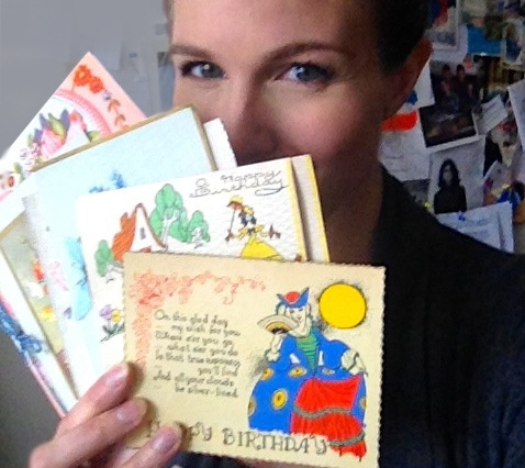 Posing with some of my collection of vintage birthday cards. You can use their best greetings next time you're stumped for a special birthday message.