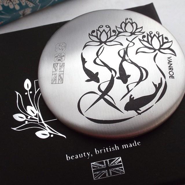 Waterlily & koi #pewter pocket mirror - entirely #madeinengland. Laser etched in black ceramic. #laser #etching #drawing #design #koi #fish #waterlily #lotus #metalwork #ukmade #madeinbritain
