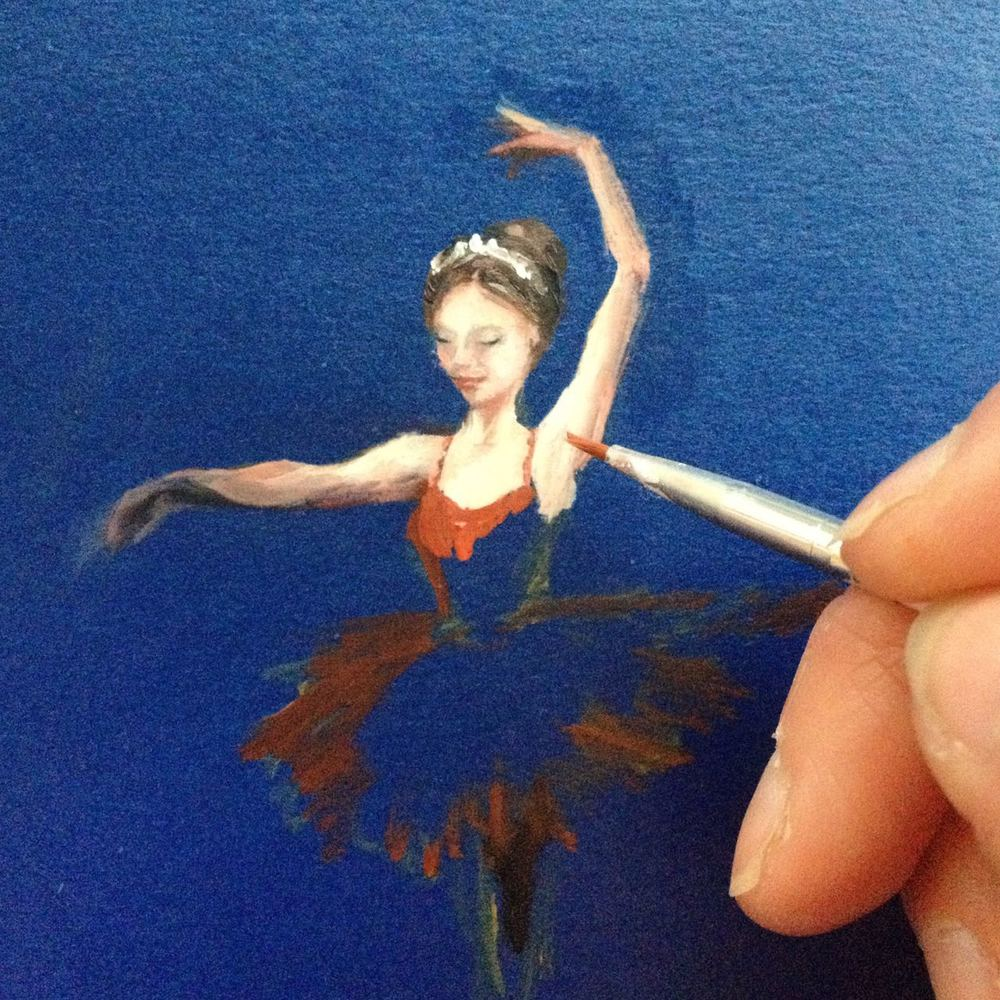 Painting in her dress, with a scarlet layer to begin. You can see quite how huge my fingers loom in this image. Excuse my nails! The ballerina really is tiny... and she's even smaller on her compact mirror stage!