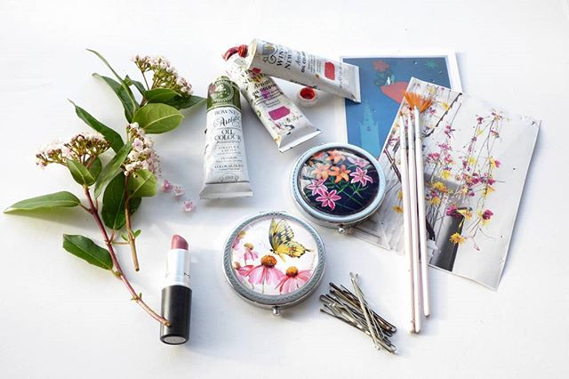 On my desk today, as requested by Yell Business for a feature they're writing on small creative companies! Garden inspiration, paints, lipstick and hair pins to keep my new fringe (bangs) out of my eyes... Oh and the pink nail art brushes I paint with! #onmydesk #onmydesktoday #mydesk #ukdesign #mydesigns #design #designer #illustration #illustrate #illustrator #photography #productdesign #productphotography #fringe #fashionblogger #blogger #saltaire #Bradford #leeds #art #yorkshire #vanroe