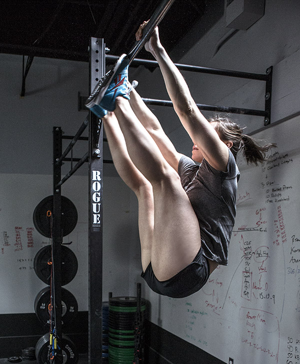 It was at this exact moment that CrossFit legend Julie Foucher realised she'd made a massive error on her toes to bar... she didn't put her thumbs around the bar!! Tut tut.