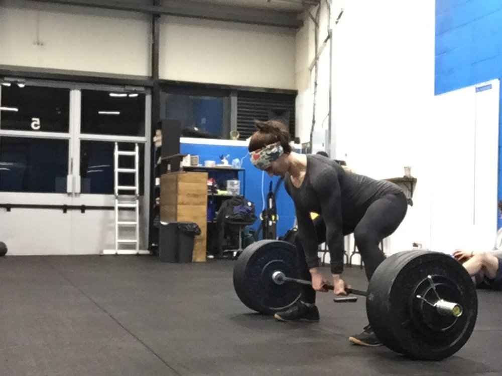 Baby Coach at 16 weeks, loving sumo deadlifts.