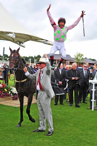 Above: Frankie Dettori and Rich Ricci celebrate Max Dynamite's win at the York Ebor Festival earlier this year.