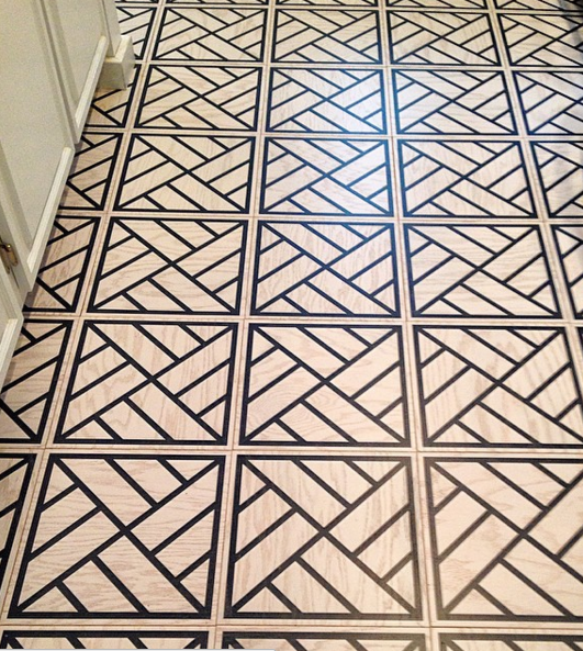 Peninsula in white and navy hardwood floor tile pattern in 12x12