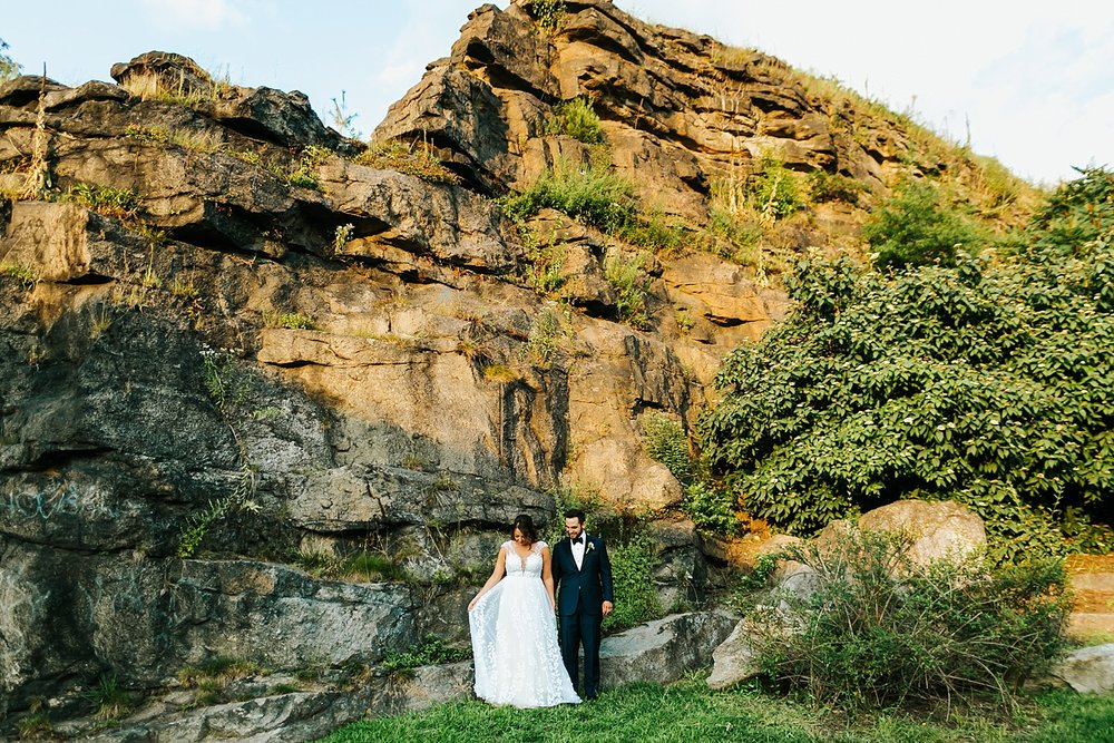 Bride and Groom in front of boulder at Water Works