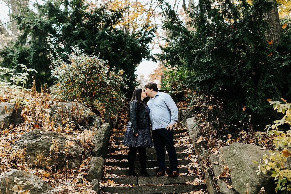 Couple kissing on steps at fort tryon