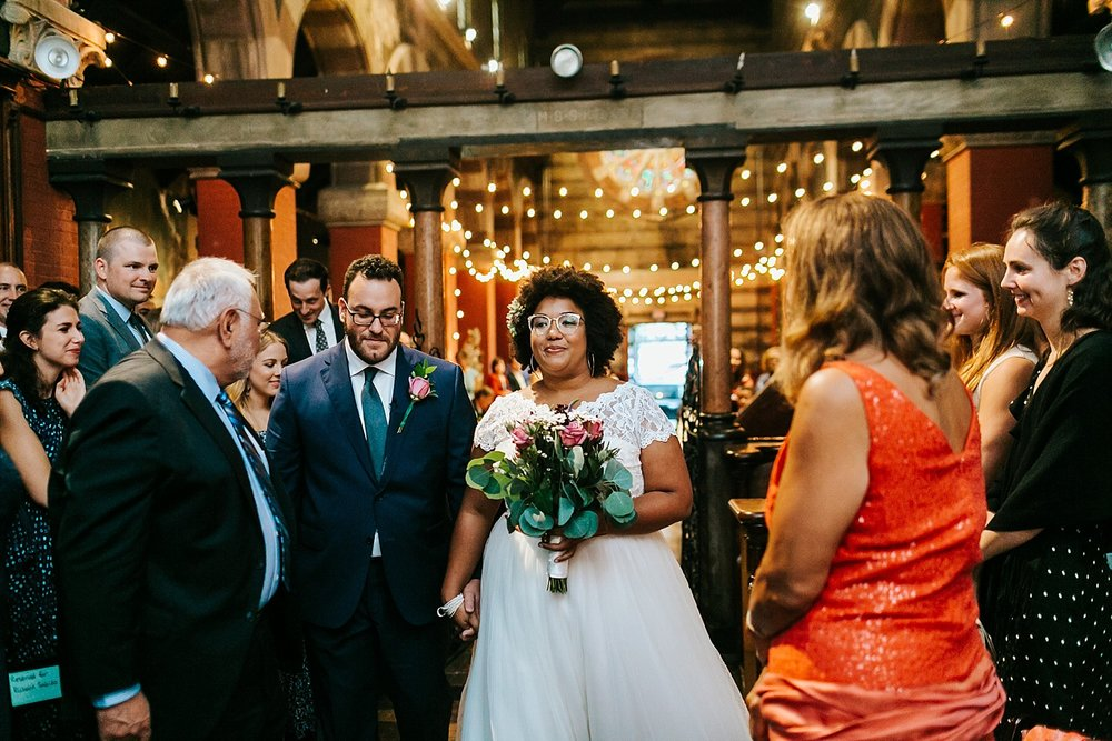 Bride and groom walking down the aisle at Fleisher Art Memorial by Danfredo Photos + Films