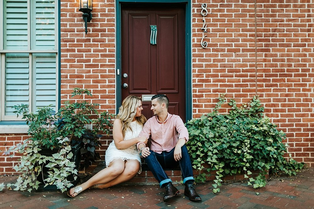 Couple sitting on a stoop at fells point