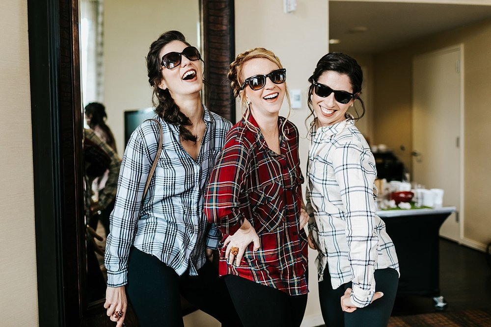 Bridesmaids wearing sunglasses at inn at penn by danfredo photos + films