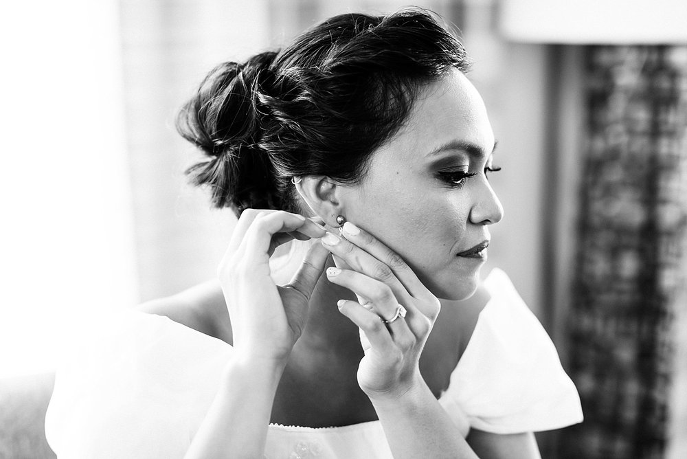 Bride putting on her earrings at inn at penn by danfredo photos + films