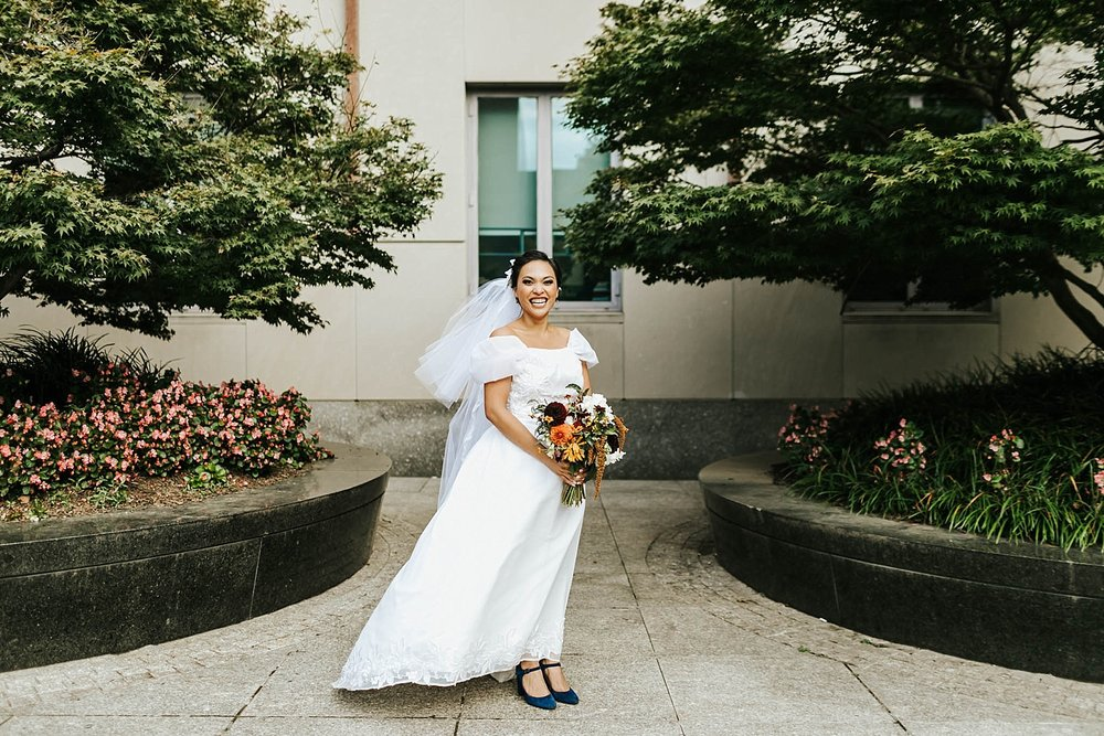 Bride holding a bouquet of flowers at inn at penn