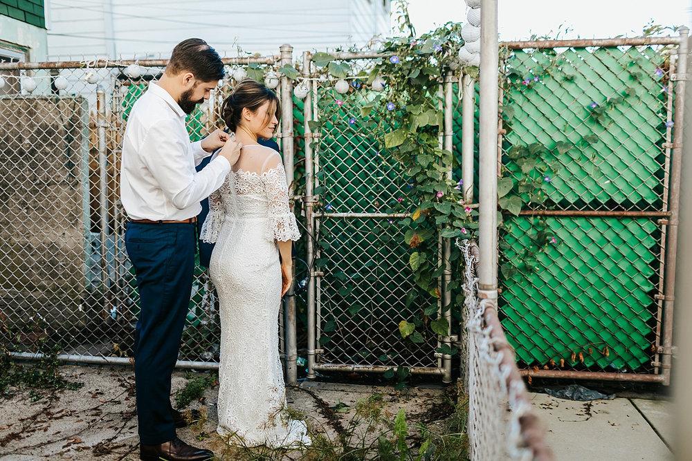 Bride and groom prep at fishtown, philadelphia