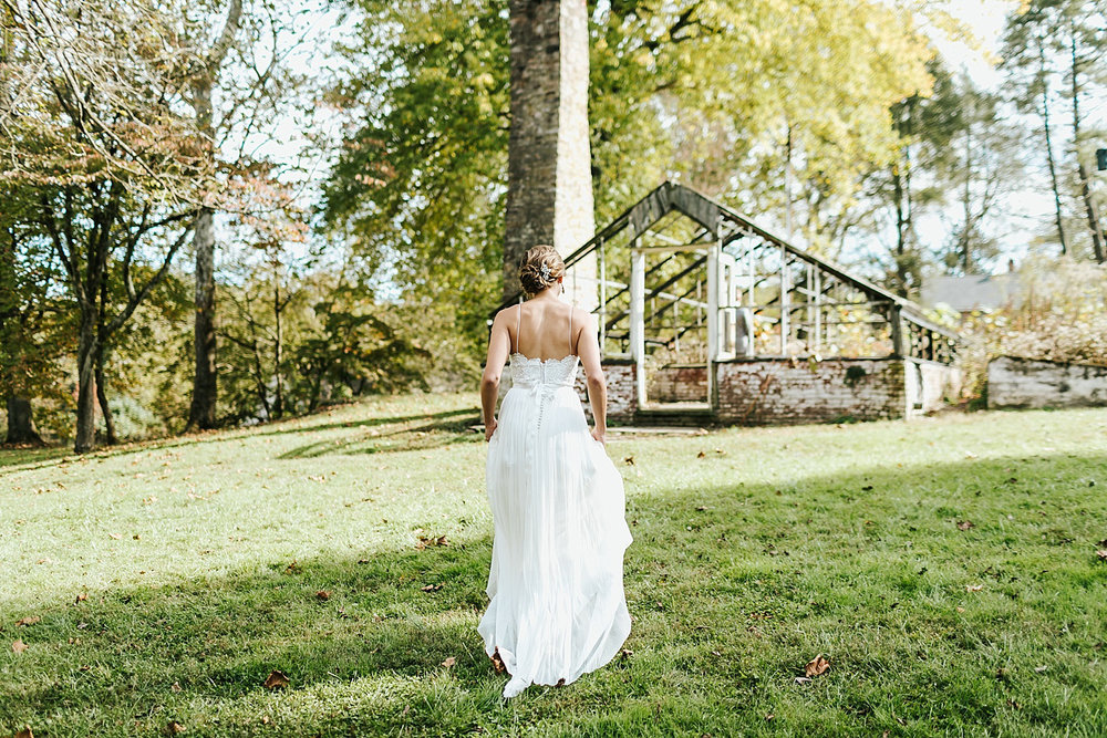 Bride walking towards plant nursery at philander chase knox