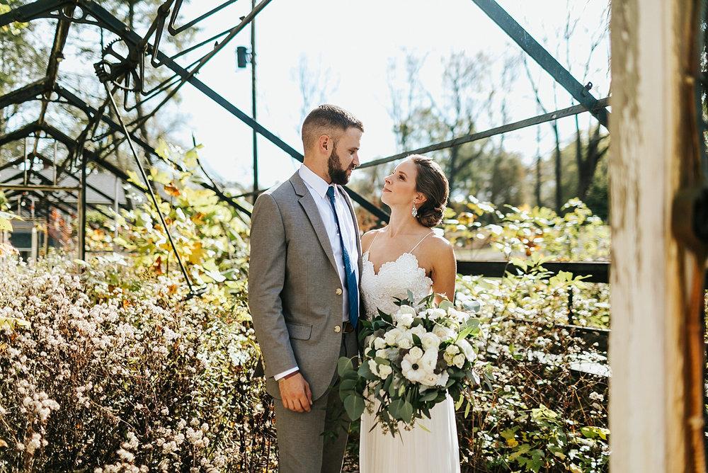 Bride and groom inside of a abandoned plant nursery