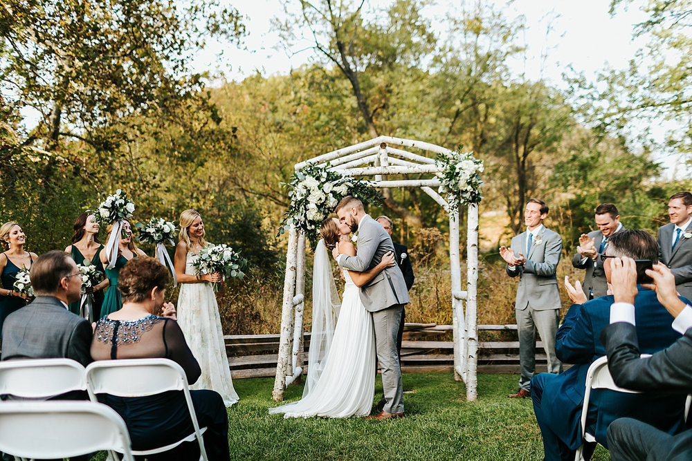 Bride and groom first kiss at philander chase knox by danfredo photos + films