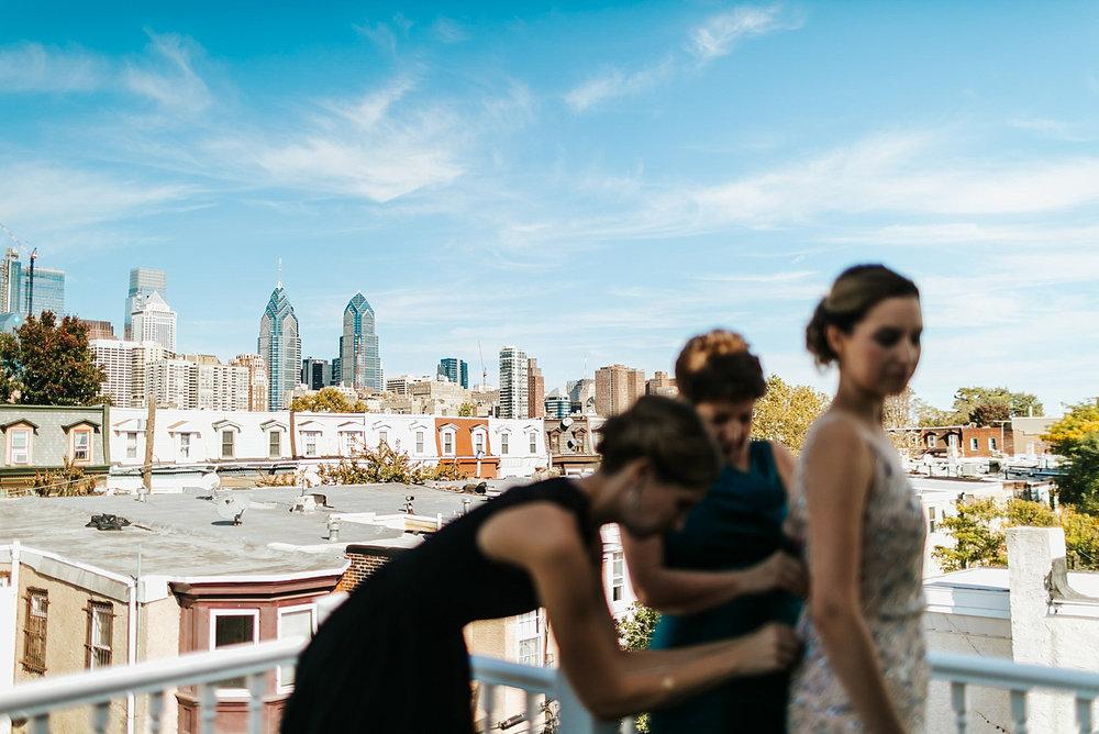 Bride getting into dress