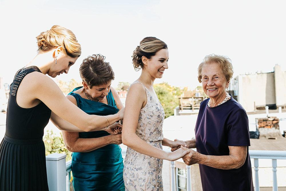 Bride getting into dress in philadelphia