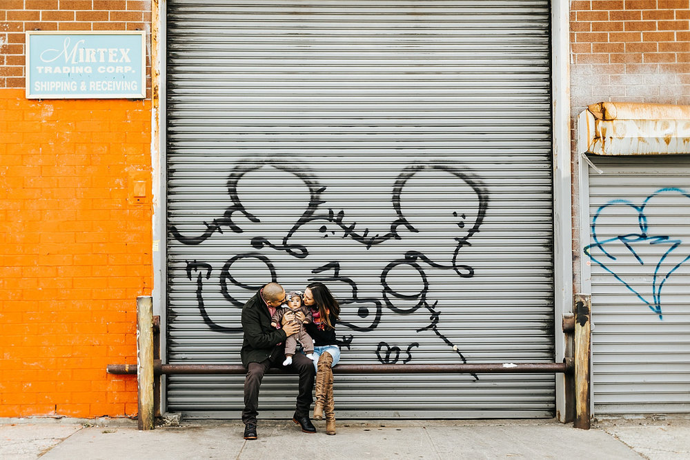 A couple with their baby at williamsburg brooklyn