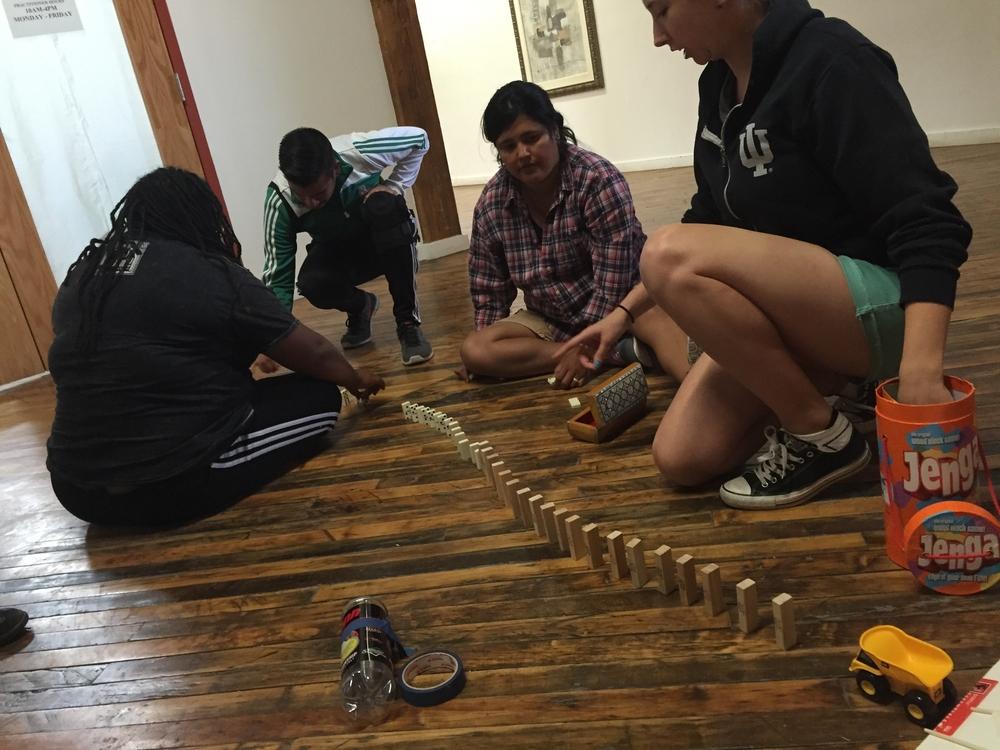 Right to left: Kari, Melissa, Mario, and Aisha construct their team machine.