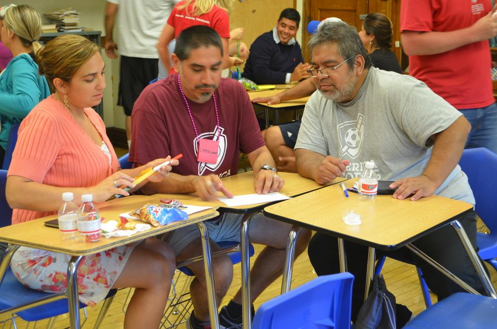 Team Castellanos works on the Iron Coach challenge.