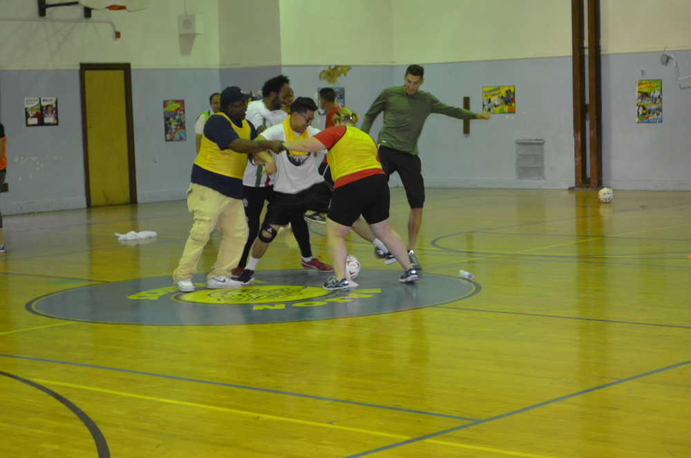 Coach Hani and Coach Fish try to steal the ball away during the soccer session!