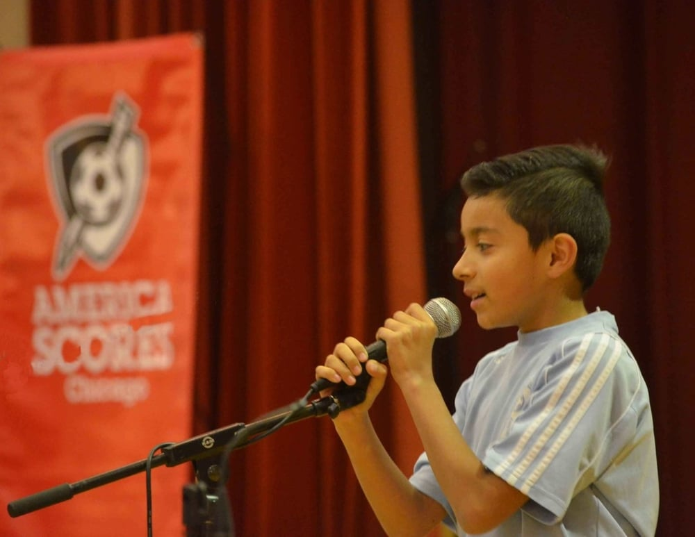 Giovanni L.. of Eli Whitney Elementary Takes the Stage at the Community Poetry Slam!