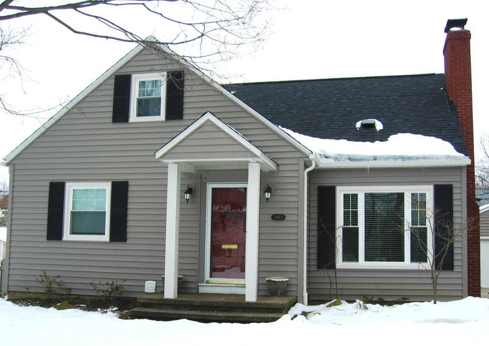 After - Kaycan Timberlake vinyl siding.