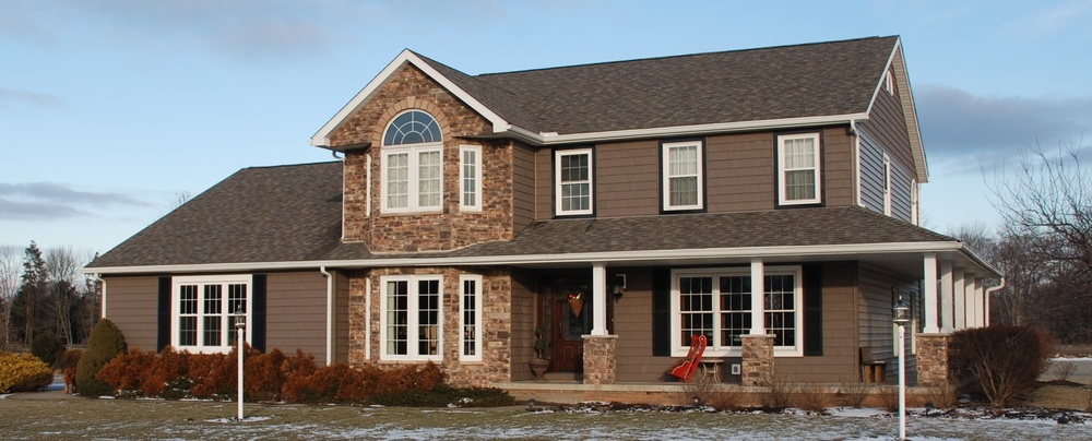 After - Cultured stone with Certainteed Cedar Impressions shake.