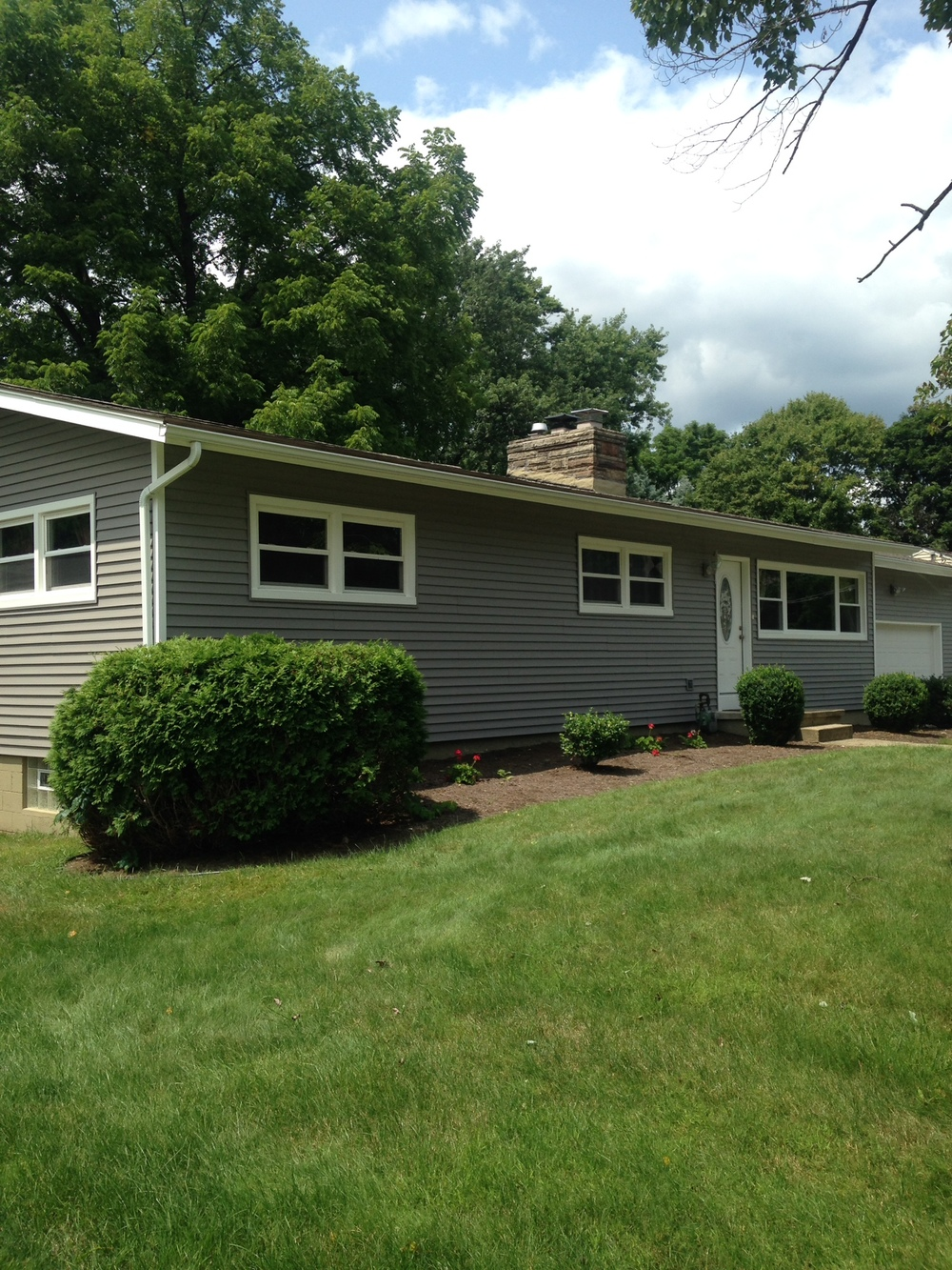 After - Royal Crest vinyl siding and replaced the window and built up the wall for a more traditional look.
