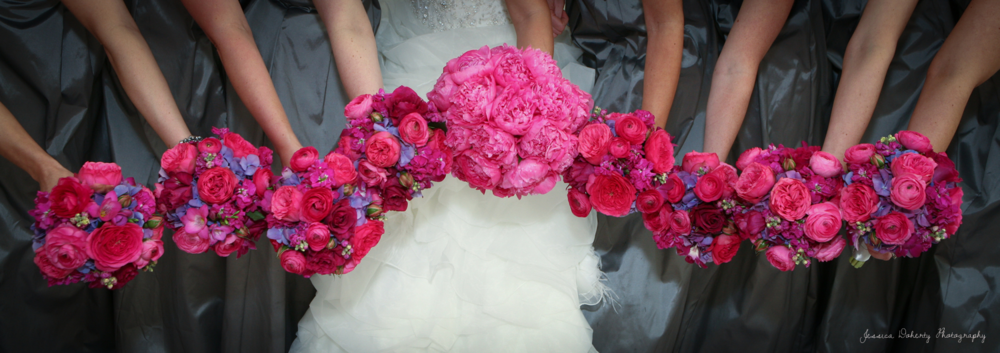 Hot Garden Roses in the Bridemaids' Bouquets and peonies in the bride's